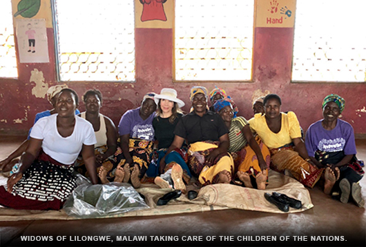 Veronica with widows of Lilongwe, Malawi taking care of The Children Of The Nations.